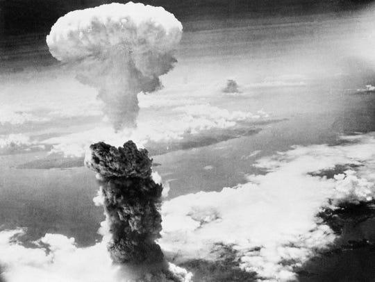 Mushroom cloud over Nagasaki, Japan, after second bomb