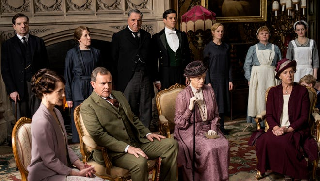 "The ""Downton Abbey"" cast gathers for a scene in Season 5. The show is ending after Season 6."