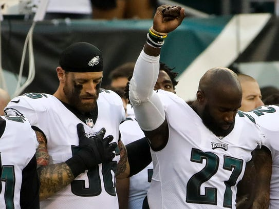 Philadelphia Eagles' Chris Long (56) stands beside