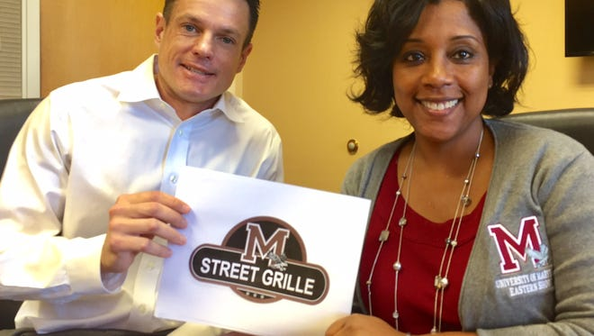 In this March 8, 2017 photo, M Street Grille owner Brandon Phillips and University of Maryland Eastern Shore executive vice president Kim Dumpson show off the logo of the restaurant scheduled to open this spring in the Princess Anne University Village shopping center. The business is a partnership between Phillips and the UMES Foundation, the university's philanthropic arm.