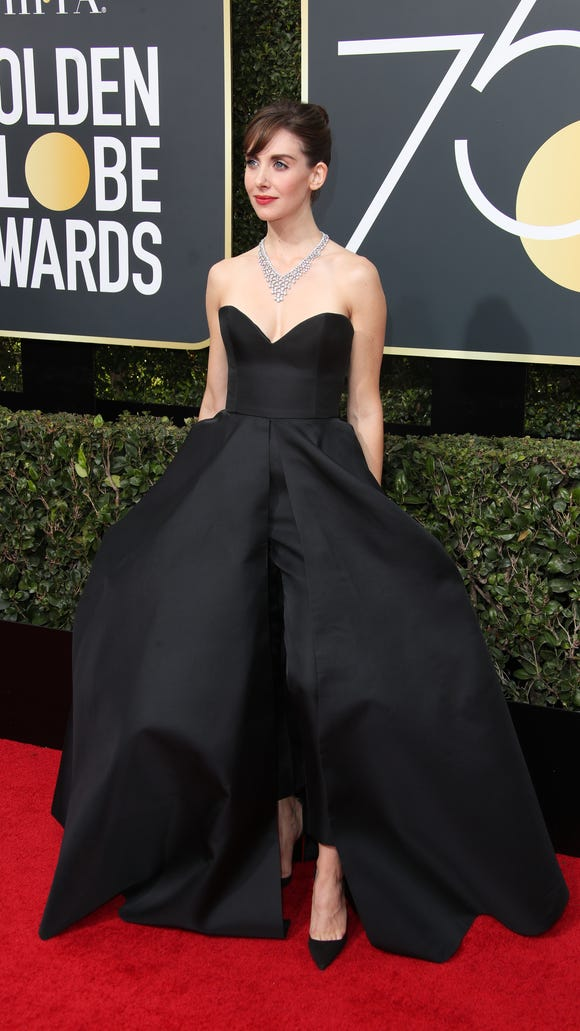 Alison Brie brought the drama to the Globes red carpet,