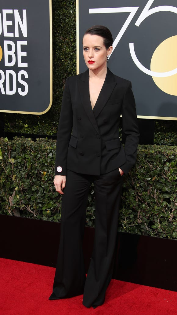 Claire Foy making the case for suits.
