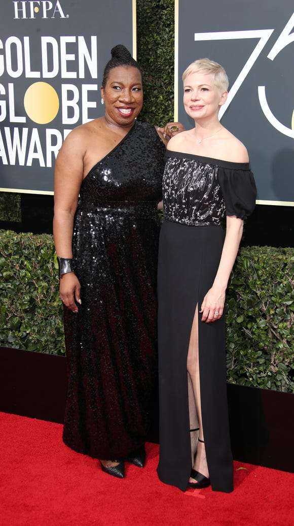 Tarana Burke, left and Michelle Williams are snapped