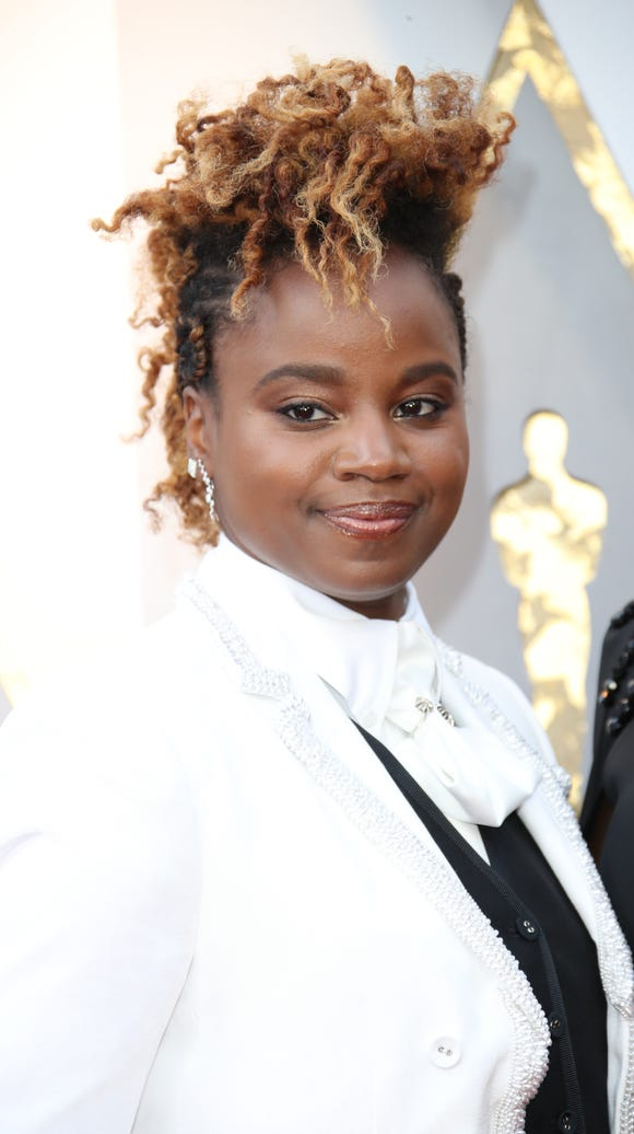 Dee Rees arrives at the 90th Academy Awards.