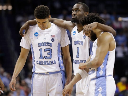 North Carolina players, from left, Cameron Johnson,