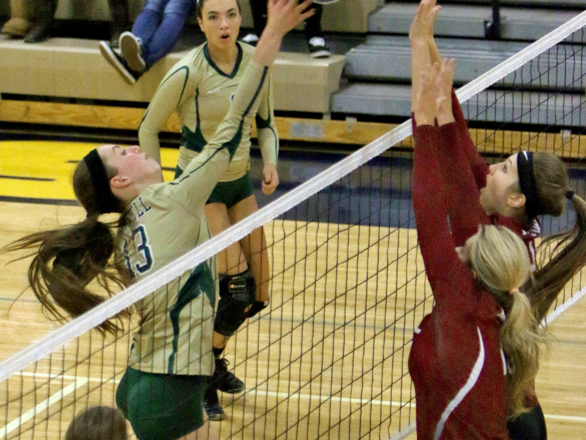 Howell's Ariana Williams puts the ball over the net in a district semifinal on Wednesday. Milford won, 3-0.