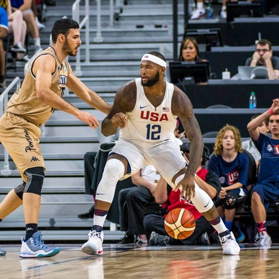 USA center DeMarcus Cousins (12) is defended by Argentina
