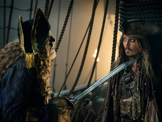 Geoffrey Rush as, left, and Johnny Depp as Captain