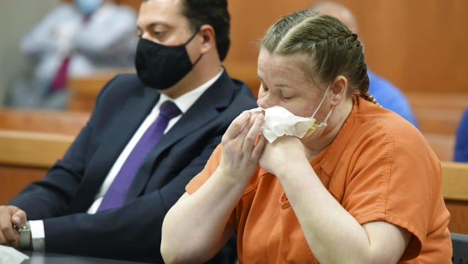 JoAnn Cunningham, cries and wipes her nose during her sentencing hearing on Thursday in Woodstock. She pleaded guilty in December to killing her five-year-old son, A.J. Freund Jr., in April 2019 in her Crystal Lake home. His body was found in a shallow grave in Woodstock.