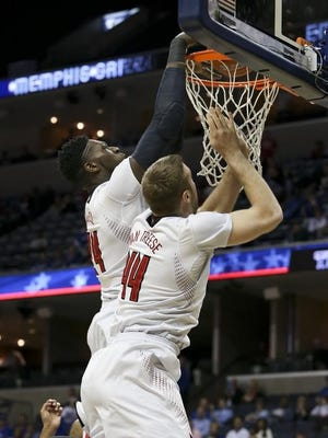 U of L's Montrezl Harrell, #24, dunks over his own teammate Stephan Van Treese, #44, during the AAC Tournament at the FedEx Forum in Memphis, Tn.