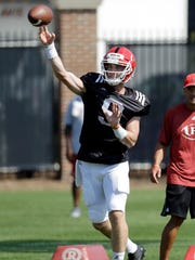 Rutgers quarterback Kyle Bolin works out during practice