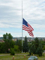 The flag on Flag Hill flies at half staff on Tuesday