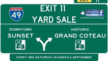 This sign advertises for the Exit 11 Yard Sale coming to Sunset and Grand Coteau Saturday.