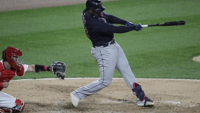 Cleveland Indians' Franmil Reyes hits an RBI double against the Chicago White Sox during the eighth inning of a baseball game in Chicago, Sunday, Aug. 9, 2020.