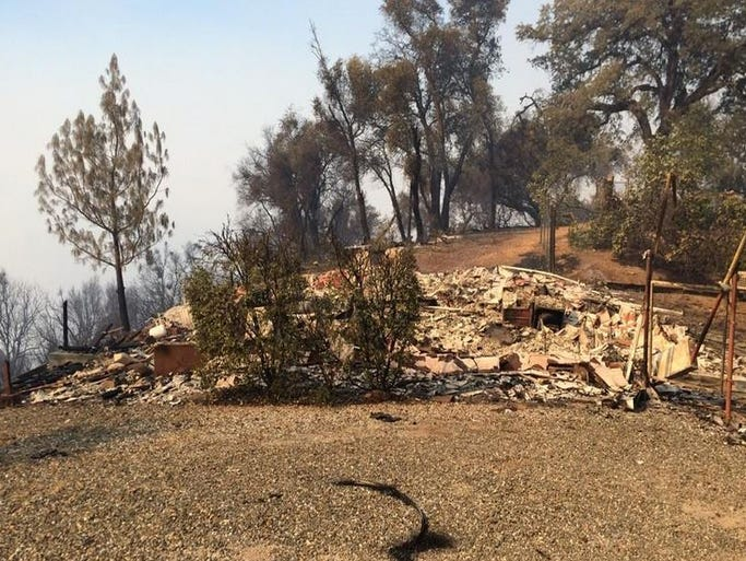 Remains of a home destroyed in the Sand Fire burning at the El Dorado-Amador county line. The fire started on Friday, July 25, 2014.
