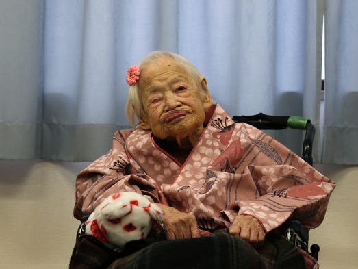 Misao Okawa, the world's oldest Japanese woman, poses