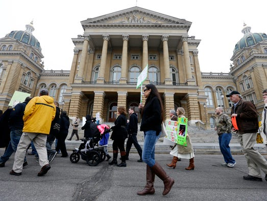 Supporters march in fron of the Iowa State Capitol