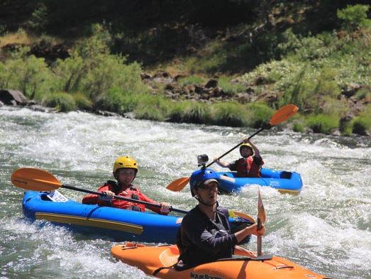Zach Urness, along with Eli and Rylan take kayaks down