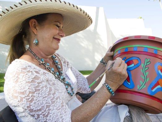 Artist Connie Adams paints at the Artfest of Scottsdale
