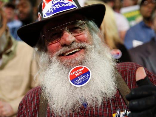 A Donald Trump supporter wears a sticker on his beard
