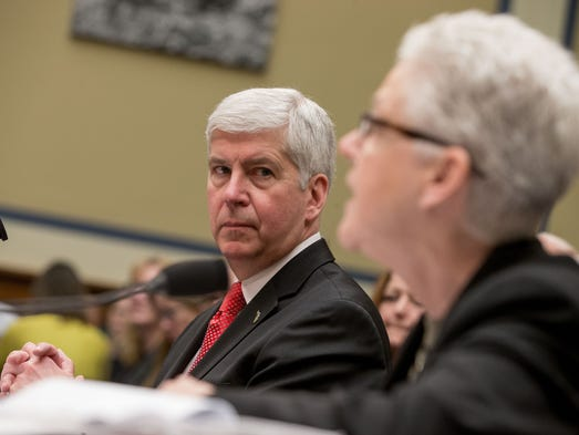 Michigan Gov. Rick Snyder listens as EPA Administrator