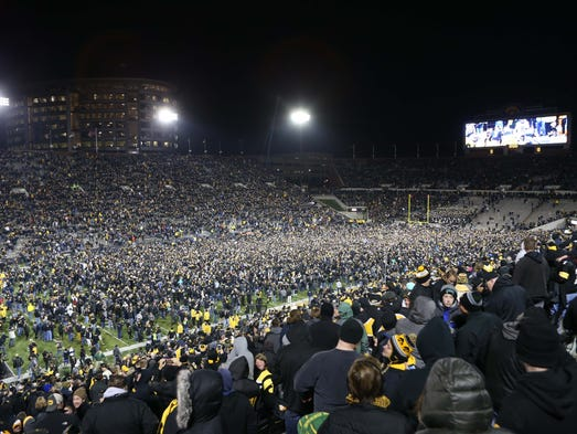 Fans storm the field after Iowa Hawkeyes place kicker