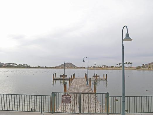 Residents enjoy a lake near Estrella Mountain Ranch