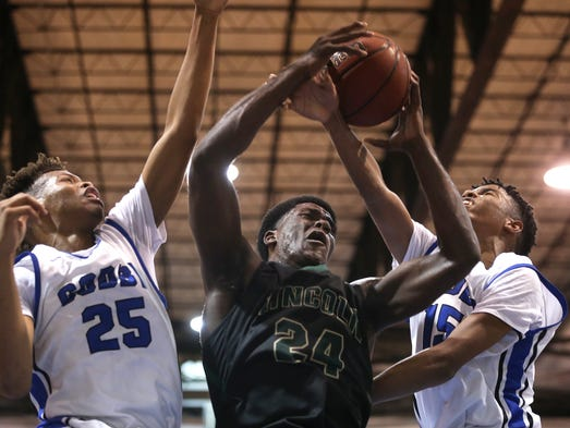Lincoln's Dwight Wilson grabs a rebound over Godby's