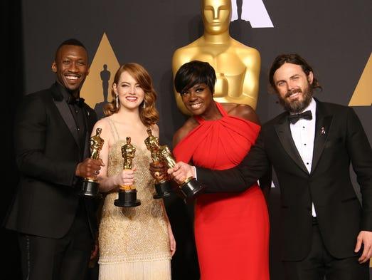 Oscar winners Mahershala Ali, left, winner of Best