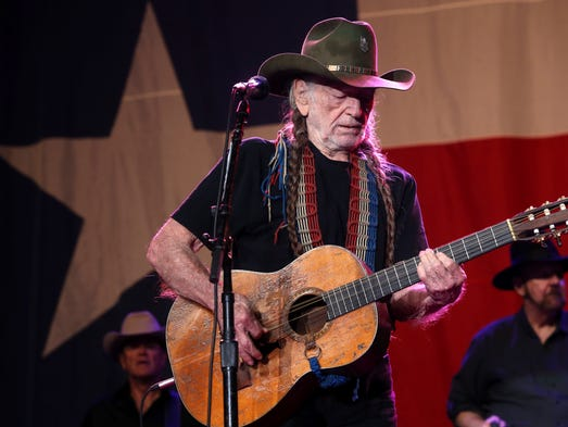 Willie Nelson performs, with opening act Dwight Yoakam