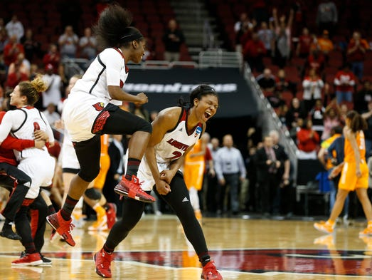 Louisville's Myisha Hines-Allen and Jazmine Jones celebrate