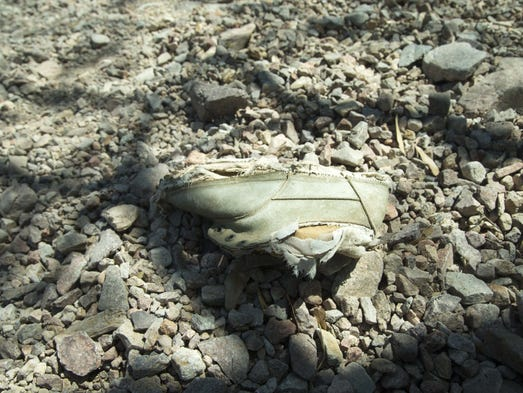 Migrant shoes left behind in the desert while Border