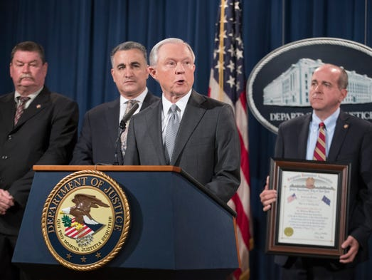 Sessions delivers remarks at an event where he received