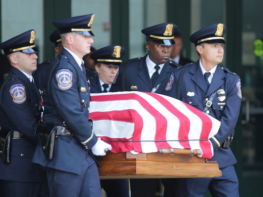 Members of the IMPD Honor Guard carry the casket of