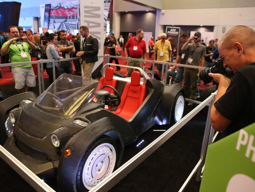 SEMA attendees line up to see the Local Motors 3D printed