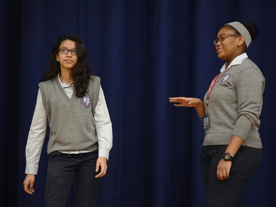 """Tenth graders Jeidy Reyes, left, and Naila Harrow of Paterson Charter School for Science & Technology, demonstrate part of a skit they performed before a recent performance of """"Hamilton."""""""