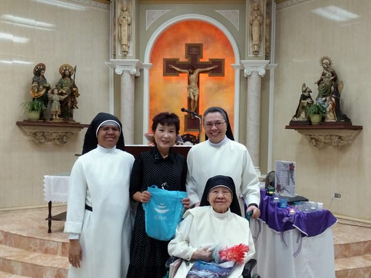 Annual donation: Yeon Sook Park a local artist's family recently donated a monetary gift bag to St. Dominic Senior Care Home for the elderly Nov. 13 and celebrated the 87th birthday of Sister Imelda Aquino,OP. The Park family has been donating and volunteering for over 18 years. Pictured from: Sister Bernardita delos Reyes, OP, Artist Yeon Sook Park, Teresita Manaloto O.P. and Sister Imelda Aquino, OP seated in front.