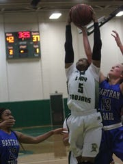 Charisse Thomas pulls down a rebound during Lincoln's