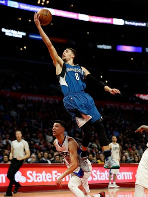 Minnesota Timberwolves guard Zach LaVine shoots over Los Angeles Clippers guard Austin Rivers, bottom, during the second half of an NBA basketball game, Thursday, Jan. 19, 2017, in Los Angeles. The Timberwolves won 104-101.