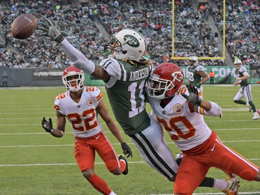 Kansas City Chiefs' Steven Nelson, right, and Marcus Peters, left, defend on an incomplete pass to New York Jets' Robby Anderson during the second half of an NFL football game, Sunday, Dec. 3, 2017, in East Rutherford, N.J. (AP Photo/Bill Kostroun)