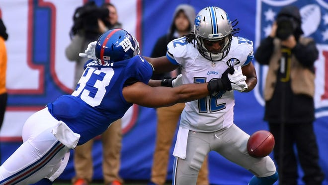 Dec 18, 2016; East Rutherford, NJ, USA; Lions receiver Andre Roberts fumbles on a return as he is hit by Giants linebacker B.J. Goodson. The ball went out of bounds with Detroit keeping possession.