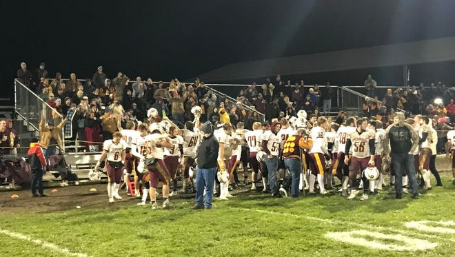 The Gibson Southern football team greets its fans after a 39-28 victory Friday at Vincennes Lincoln in a 3A Sectional 32 semifinal.