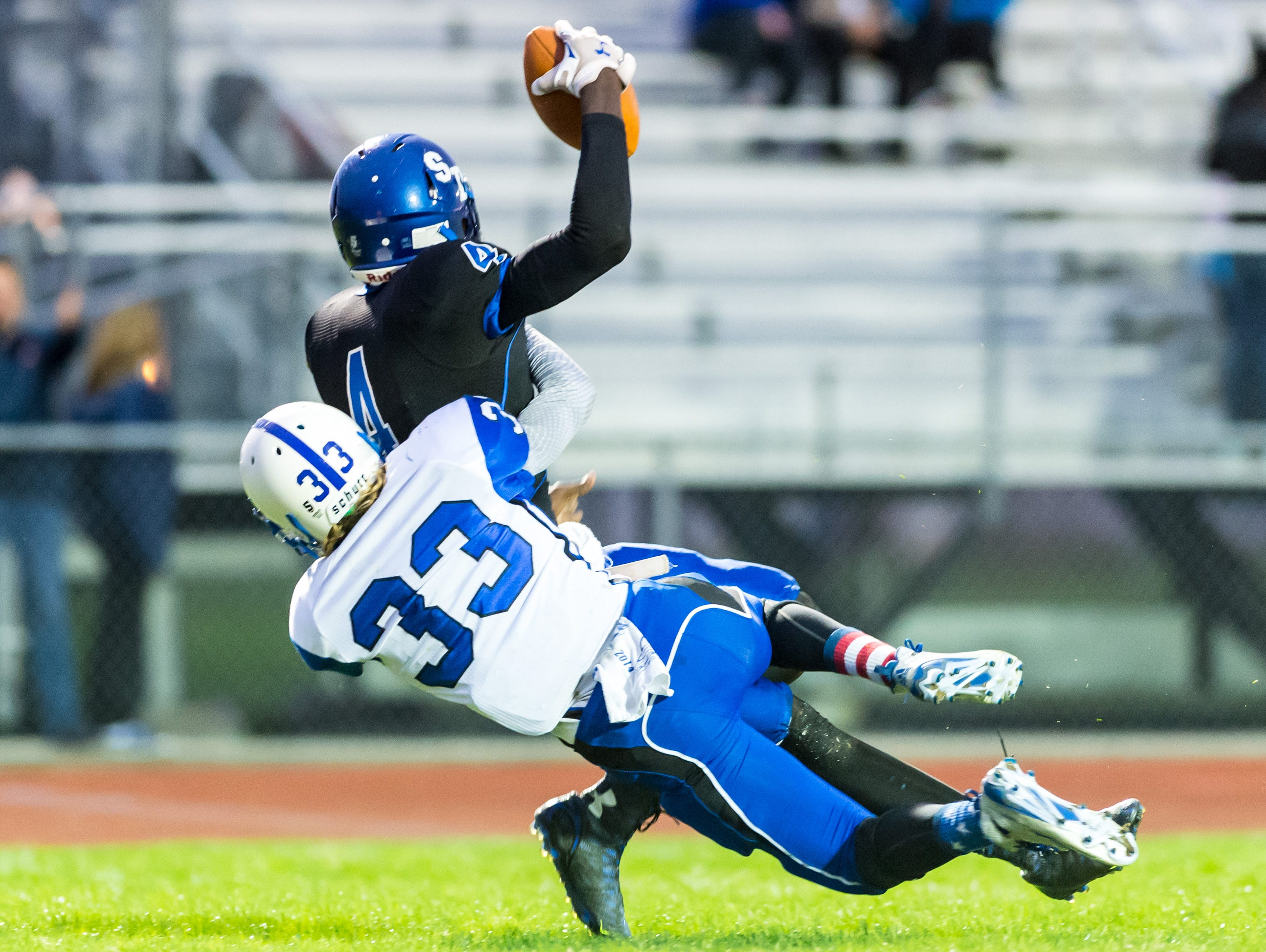 Stephen Decatur wide receiver Tyree Henry (4) hauls in a touchdown catch against North Caroline. Catches like this made Henry a threat this season before tearing his ACL.