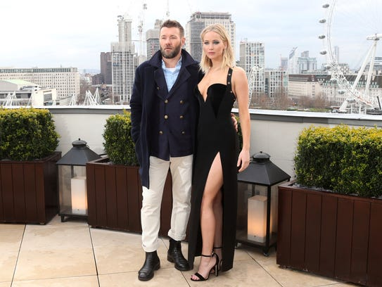 """Jennifer Lawrence (with Joel Edgerton) called controversy that sprang up because she didn't wear a coat over this Versace dress in London """"utterly ridiculous."""""""
