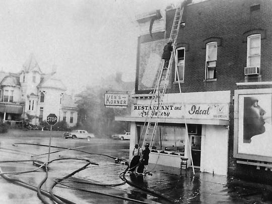 A two-story brick building at Center and Green streets had its roof demolished by fire in an early Sunday morning blaze July 21, 1968. The fire damaged eight apartments and two commercial establishments, Ken's Korner restaurant and the Louie Don Beauty Shop. Several minor injuries were reported.