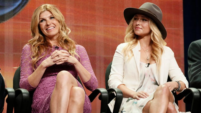 """In this file photo, cast members Connie Britton and Hayden Panettiere attend the """"Nashville"""" panel at the Disney ABC TCA Day 2 at the Beverly Hilton Hotel, in Beverly Hills, Calif. Cancelled by ABC after four seasons, the new season of """"Nashville"""" on CMT, which begins Jan. 5, 2017, aims to reflect more diversity in both the music and the cast."""