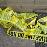 Remnants of crime scene tape remain on the ground in Chicago.