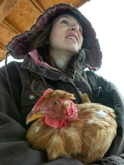 Shelly Richard is pictured with one of the many chicken