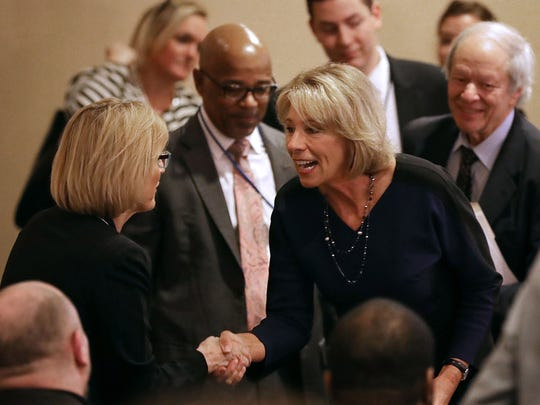Education Secretary Betsy DeVos greets employees on her first day on the job at the Department of Education February 8, 2017 in Washington, DC.