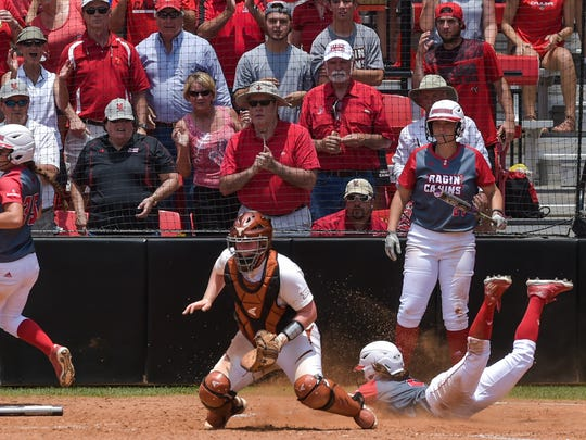 Kassidy Zeringue slides into home ahead of the throw as the Cajuns beat Texas 9-1 on the second day of NCAA Lafayette Regional.